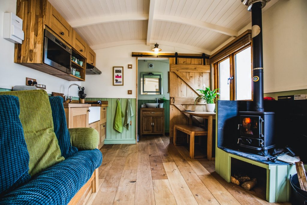living room with woodburner and double futon which turns into a double bed